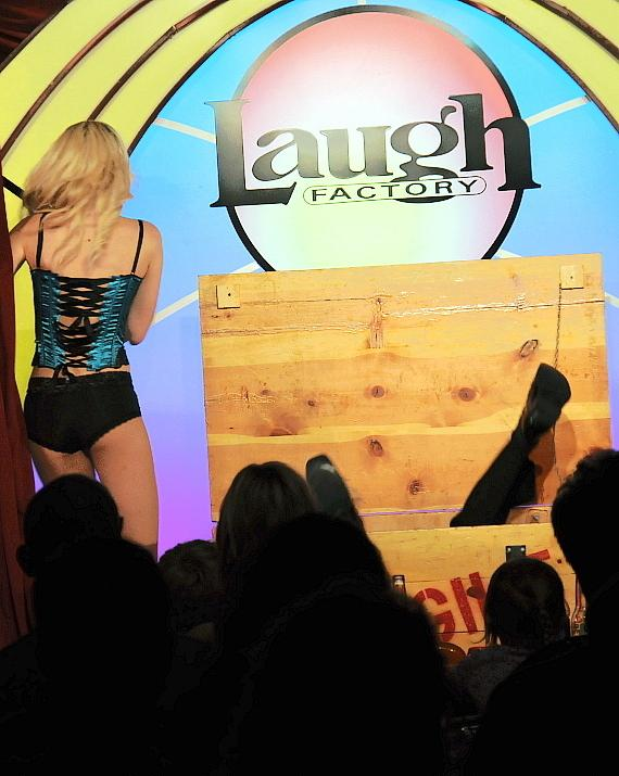 "Murray SawChuck performs the ""Surprise Crate Illusion"" in 'MURRAY Celebrity Magician"" at Laugh Factory in The Tropicana Las Vegas"
