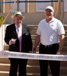 Former Mayor Oscar B. Goodman and Mark Prows, Vice President of Entertainment for MGM Grand, prepare to cut the ribbon
