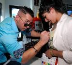 The Situation making a female fan feel special at Sugar Factory for his Couture Pop launch