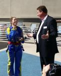 Tim Kuykendall, Vice President of Hotel Operations at Stratosphere Hotel, Casino & Tower informs Ruby J. that she is the 200,000th SkyJumper