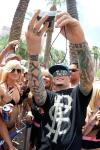 Vanilla Ice takes pictures with fans at Flamingo GO Pool in Las Vegas