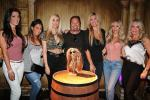Vince Neil (center) poses with girlfriend Rain Hannah and friends at The Golden Tiki