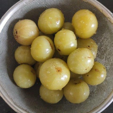 boiled amla in colander