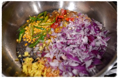 Adding onions,ginger,green chillies and red chillies to the tempering