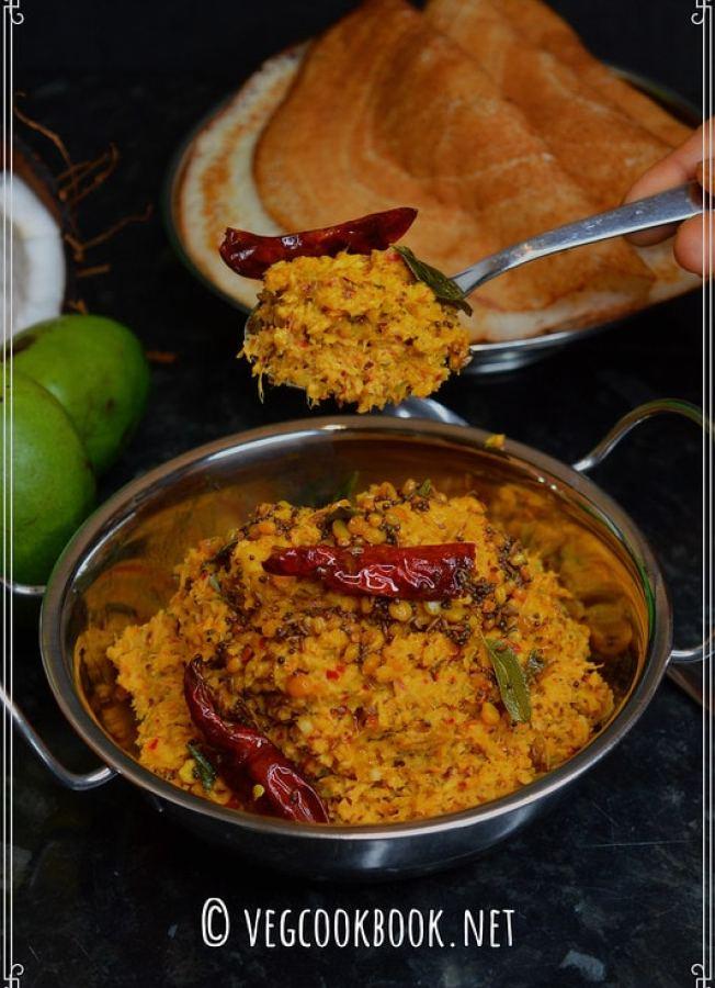 raw mango coconut chutney / mamidikaya kobbari pachadi. South Indian, Andhra style spicy recipe for rice, made without using tamarind.
