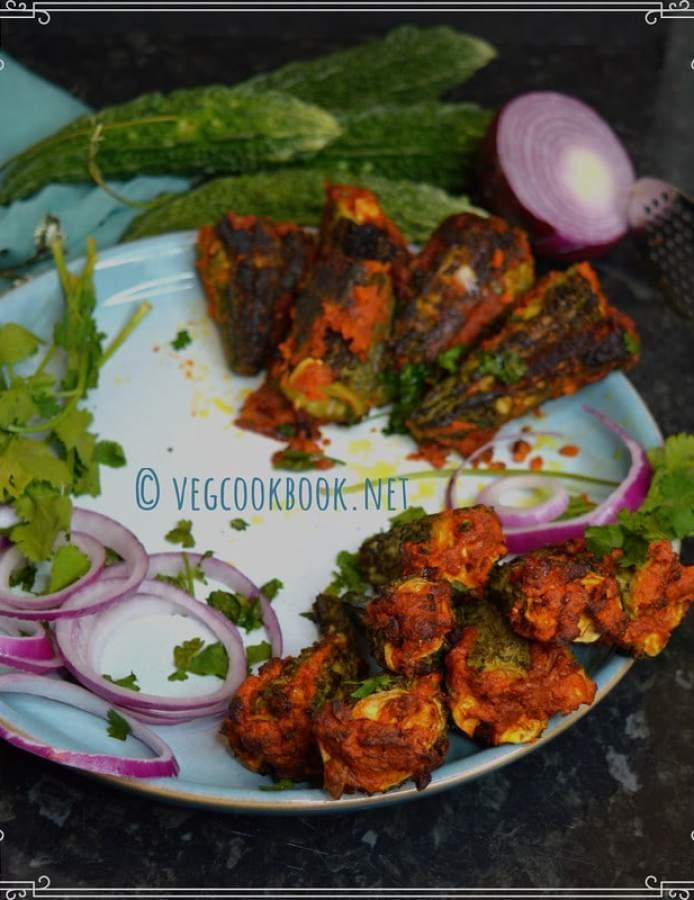 stuffed bittergourd / bharwa karela / kakarakaya ulli kaaram koora.Andhra style bharwa curry recipe with bitter melon, little oil, air fryer and stove top methods.