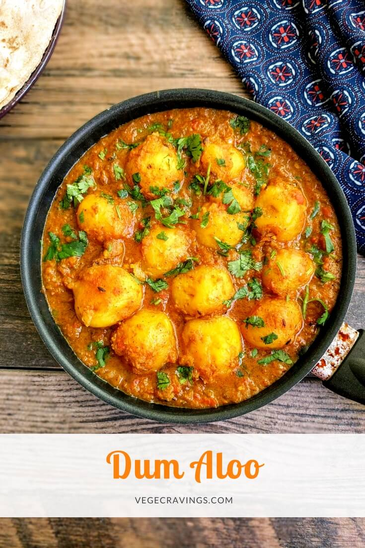 Dum Aloo is a delicious Indian Gravy made with fried baby potatoes slow cooked in a spicy onion, tomato and curd based gravy.