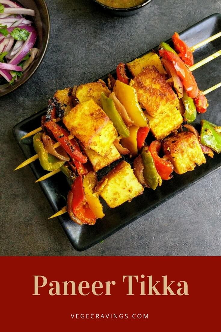 Paneer Tikka is a popular spicy Indian appetizer made by marinating chunks of Paneer & vegetables in a spicy Yogurt paste and then grilling them.