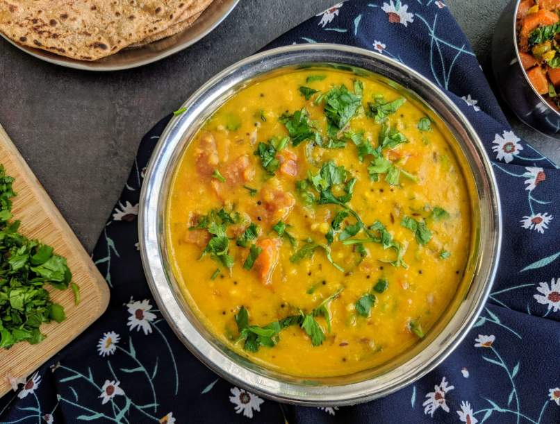 Moong Dal Tadka is a simple Indian dish made from yellow moong lentils cooked with a tempering made of onion, tomato and spices.