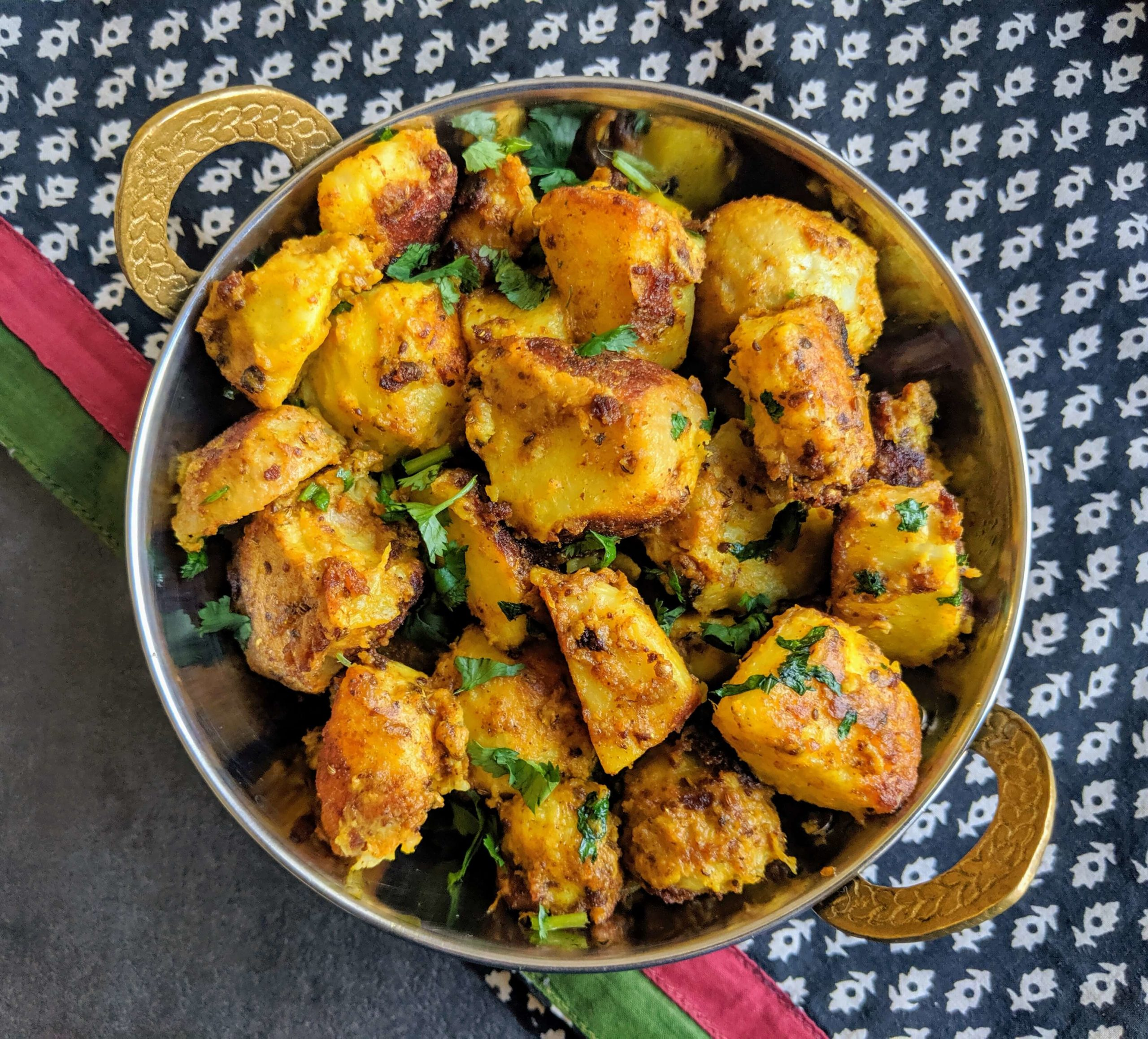 Arbi ki sabji is a crispy & spicy Indian dry curry made by stir frying arbi (taro roots) along with a unique combination of spices.