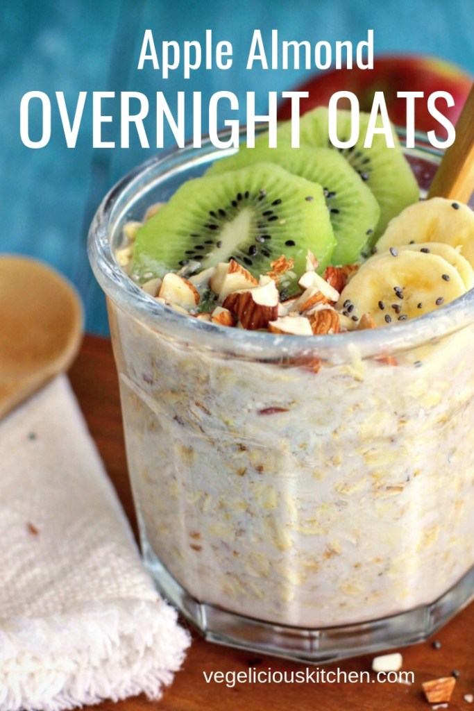 Apple almond overnight oats in a glass jar with fruit and nuts on top