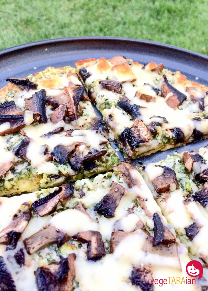 Mushroom pizza with chive and almond pesto