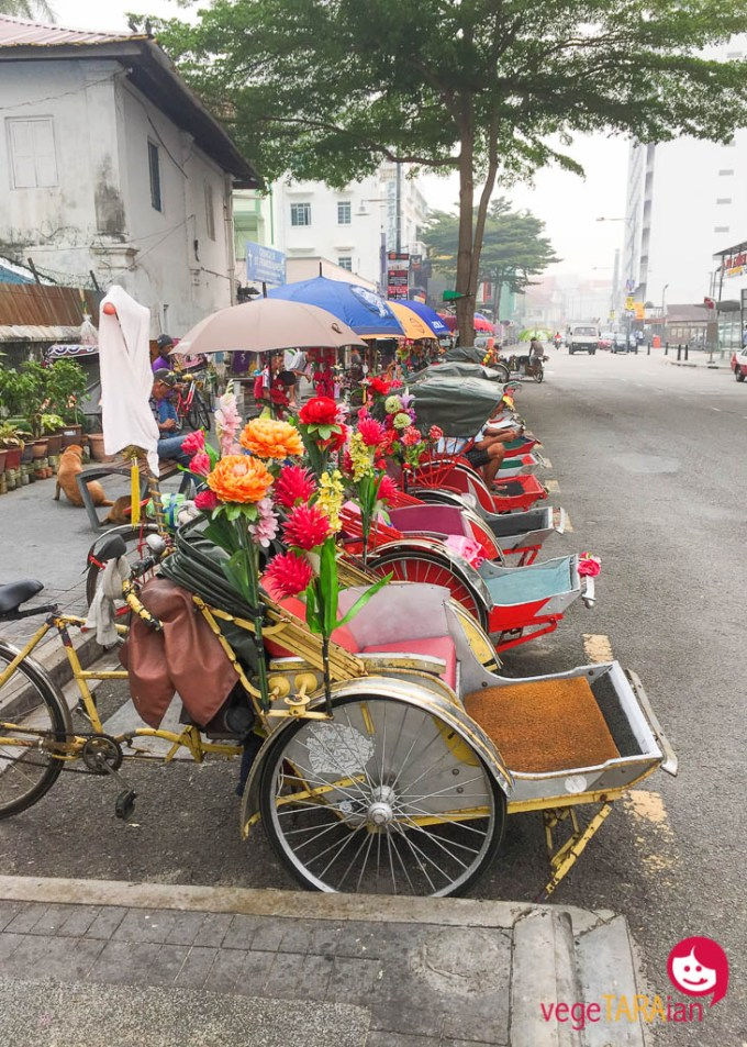 Trishaws lined up on the street in Penang, Malaysia