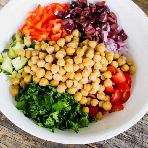 Mediterranean Salad recipe ingredients inside of white bowl