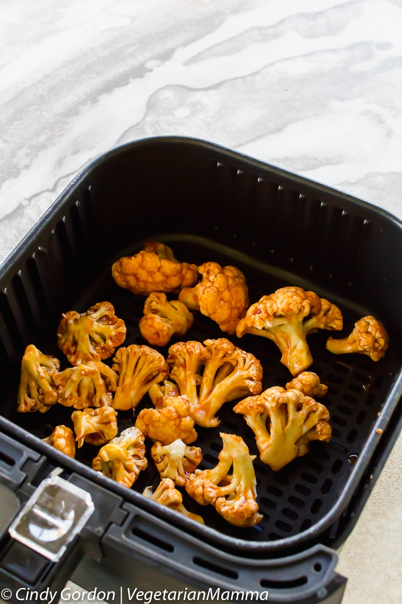 Air Fryer Honey Sriracha Cauliflower in the air fryer basket