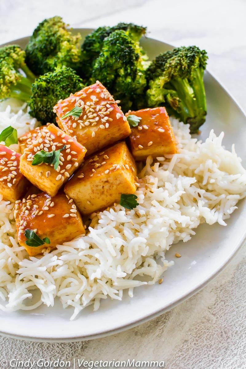 Honey Sriracha Tofu  served on top of rice with broccoli.
