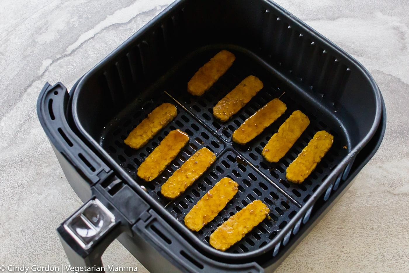 Vegan Air Fryer Bacon in air fryer basket