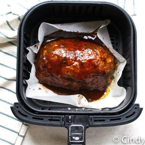 Air Fryer Meatloaf in air fryer baskets with a beautiful deep marroon glaze on top