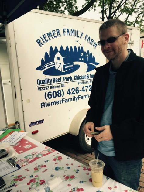 Jeremy stopped by the Riemer Family Farm table so he could arrange to bring home the bacon.