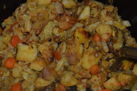 Dutch Oven Potatoes, Cabbage, Onion and Carrots.