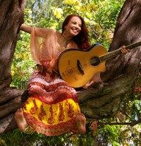 Kiana Luna in tree with guitar