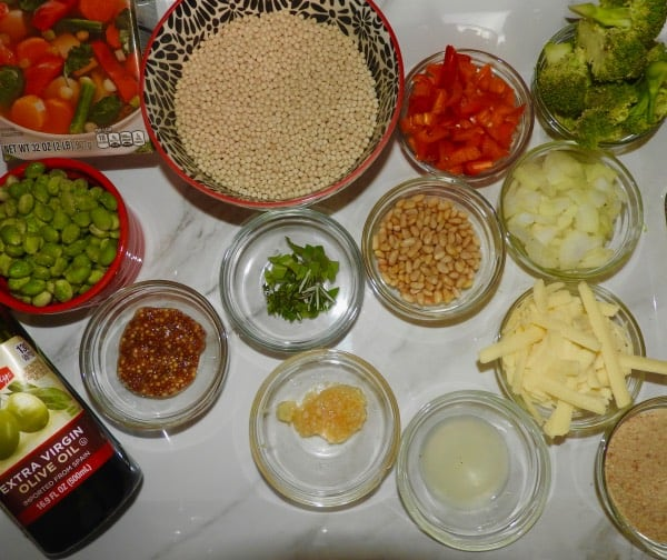 ingredients for pearled couscous dish on marbled tray