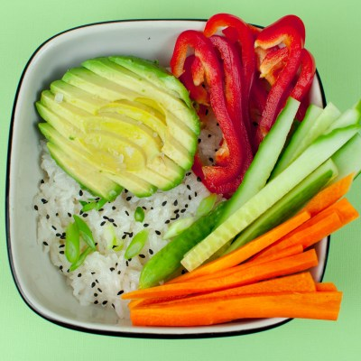 Sushi Bowl with Avocado, Red Bell Pepper, Cucumber, Carrot, Scallion, and Black Sesame Seeds