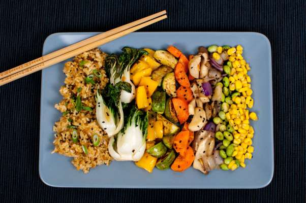 Vegan Fried Rice with Scallions, Sesame Seeds, Baby Bok Choy, Yellow Bell Pepper, Mayan Squash, King Oyster Mushrooms, Carrots, Edamame, Red Onion, and Corn