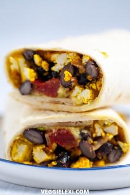 Easy vegan and gluten free breakfast burritos with scrambled tofu, salsa, avocado, and black beans. - by Veggie Lexi
