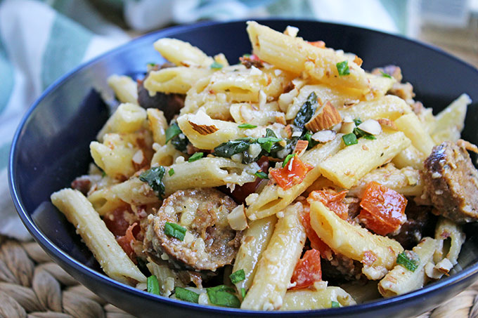 Vegan Italian Sausage Almond Pasta with fresh spinach, tomatoes, lemon, and crushed almonds is a great weekday meal that is ready in 35 minutes.