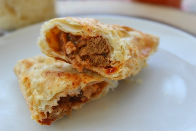 Veggie Sausage Pizza Turnovers make a great side dish to accompany any Italian meal. Firm, flaky crust wrapped around a filling of warm, cheesy goodness.
