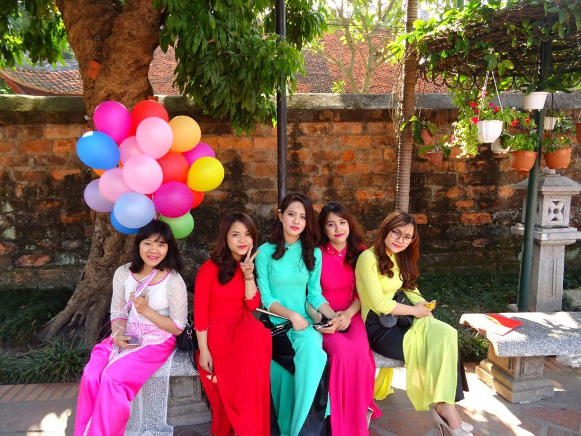 Vietnamese beautiful girls wearing traditional dresses