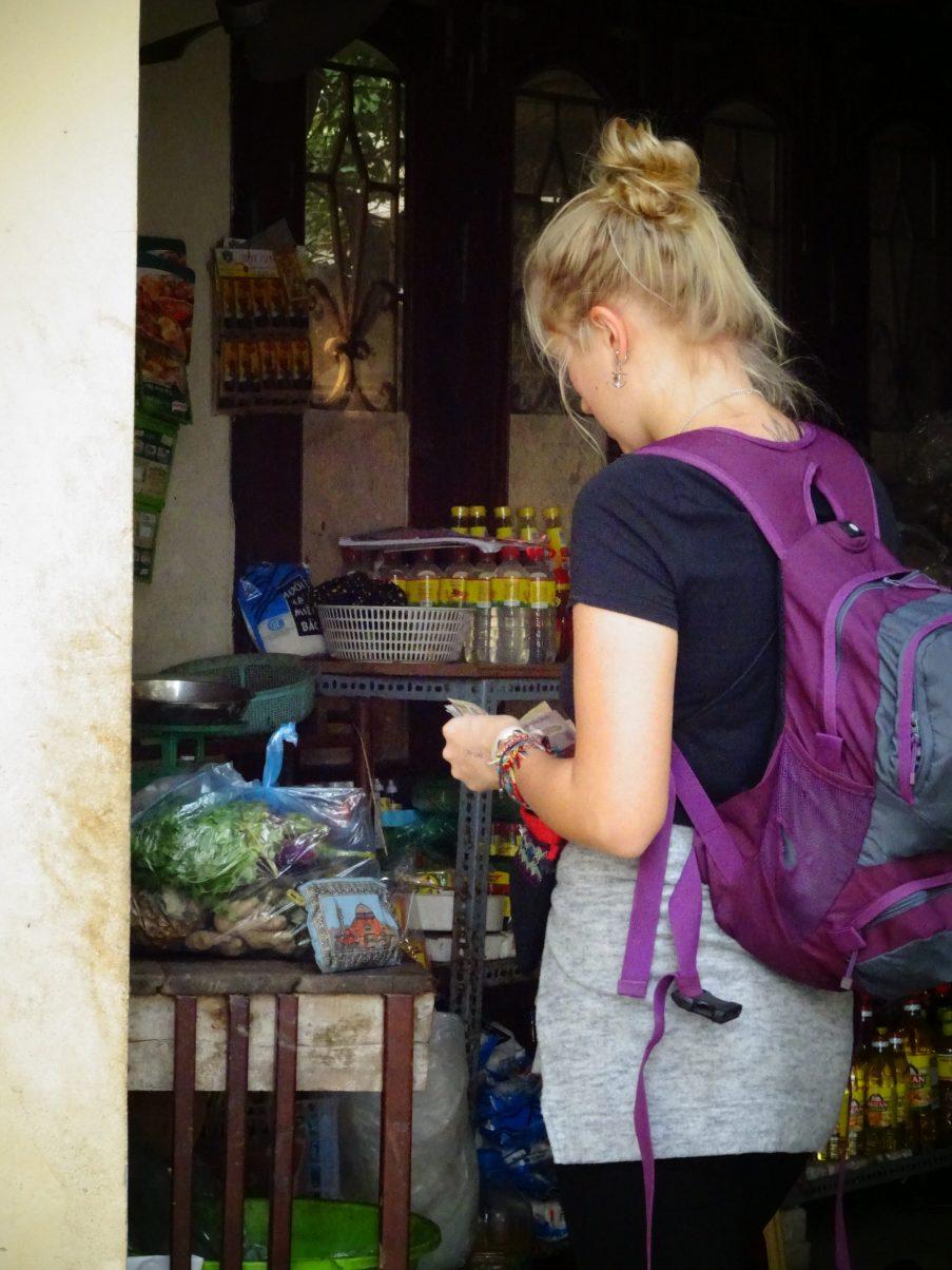 Girl buying from market in Hanoi, Vietnam