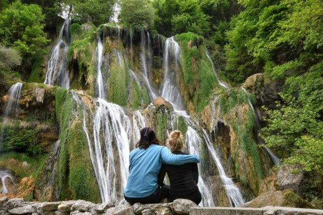 Couple in front of waterfall