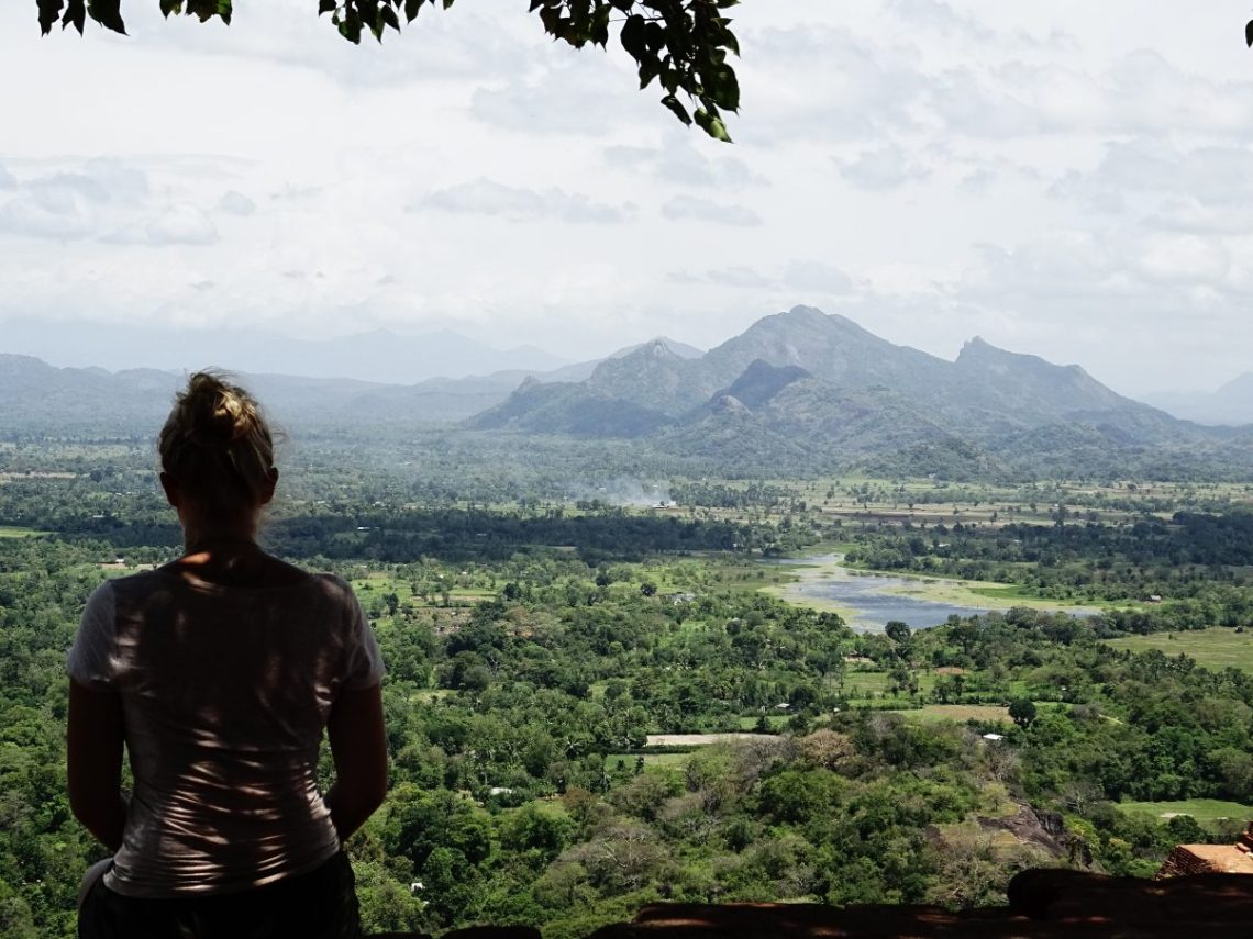 Girl overlooking mountain view