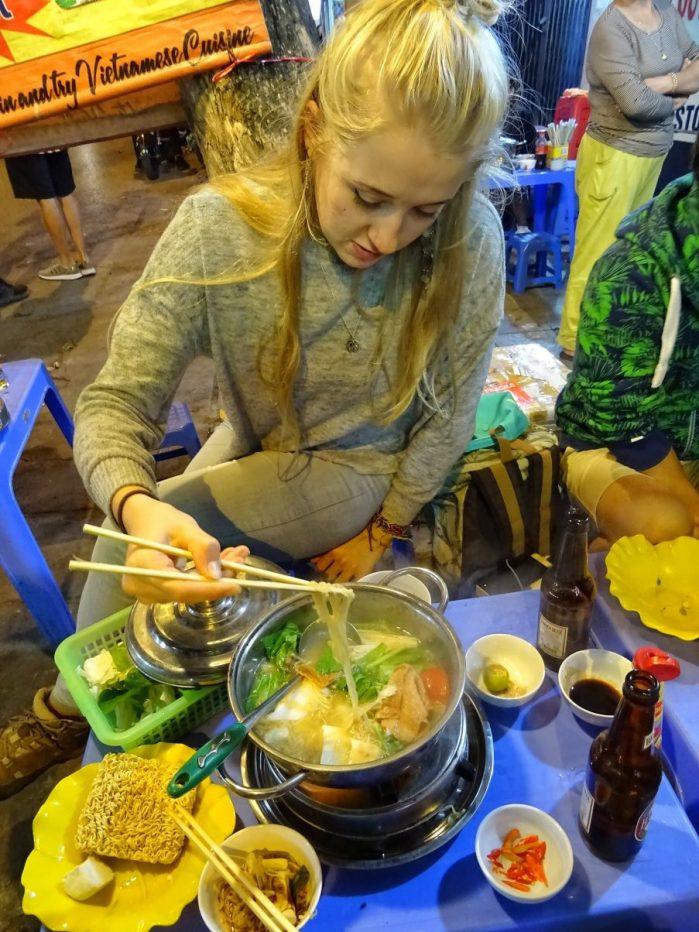 Girl eating vegan hot pot in Vietnam
