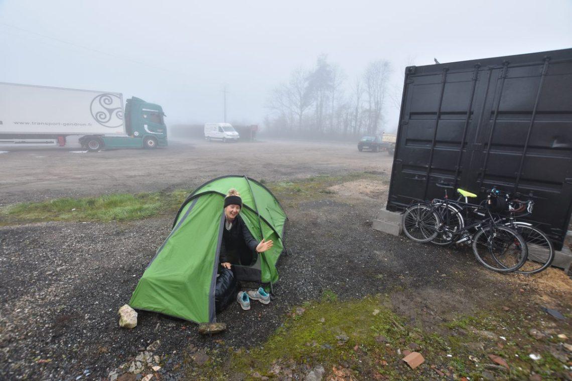 Girl camping in carpark