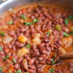 Beans roasted in tomato sauce with potatoes