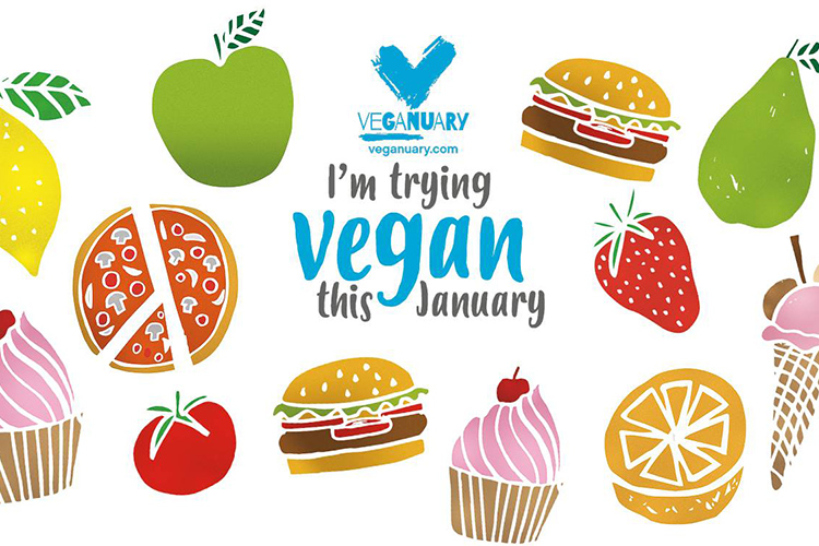 Texten I'm trying vegan this January med illustrerade frukter, glass och burgare runt om