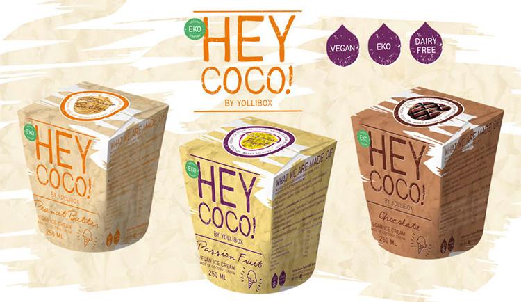 Illustrerad bild på tre pappersboxar med texten HEY COCO!