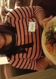 Lady with plate of vegan food
