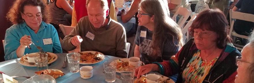 People eating at a circular table