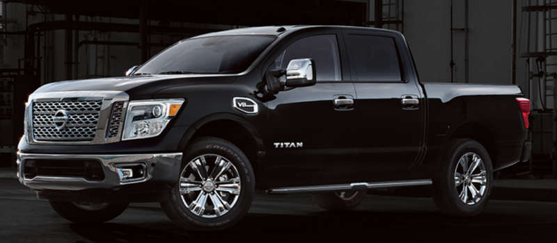 Black 2017 Nissan Titan against a black background