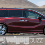 Photograph of sideview 2018 Honda Odyssey on road