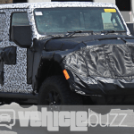 Spy Photo of underwraps 2018 Jeep Wrangler on the road.