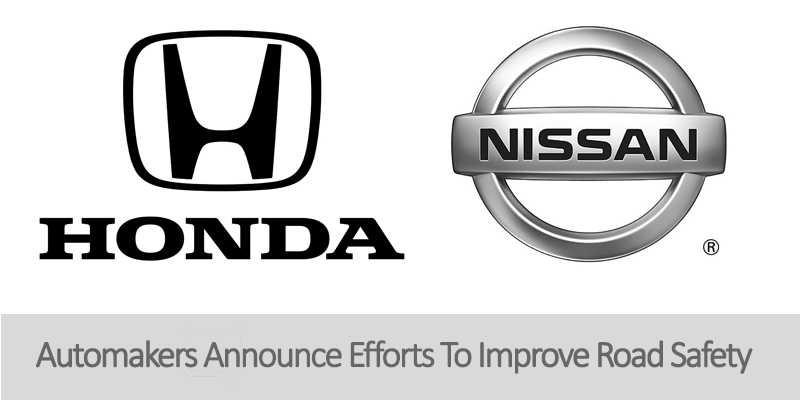 Japanese auto maker logos for Nissan and Honda on white background