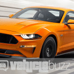 Photo of orange 2018 Ford Mustang speeding down road.