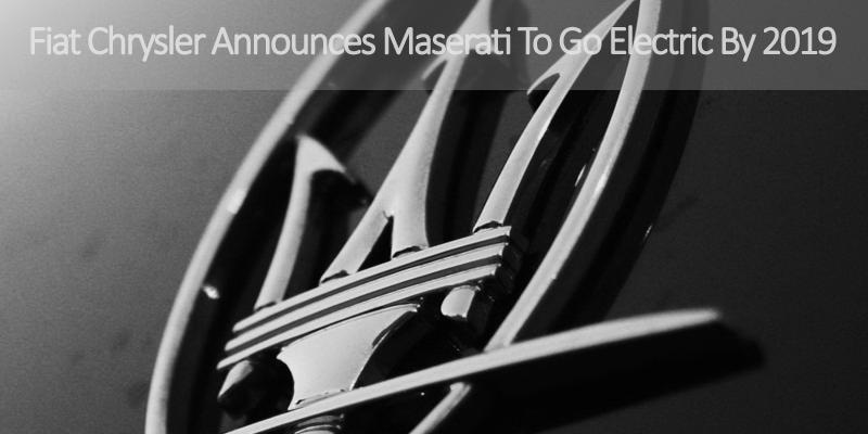 Closeup photo of Maserati logo on black vehicle.