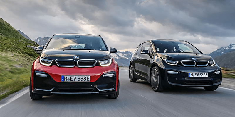 photo of standard and sport 2018 BMW i3 racing along a mountain road