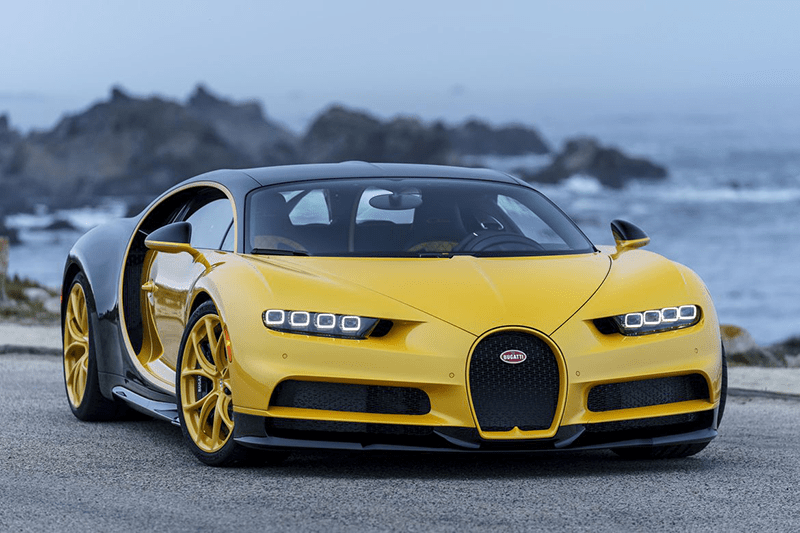 Yellow and black 2018 Bugatti Chiron by the ocean.